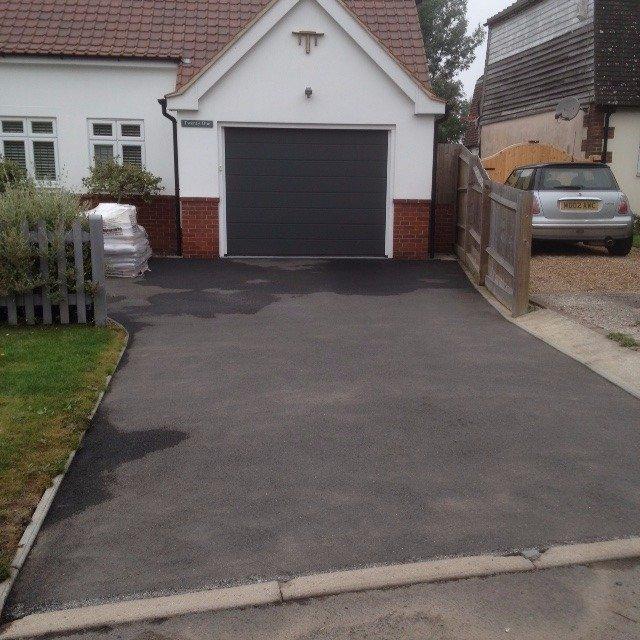 Customers driveway at property before resurfacing work