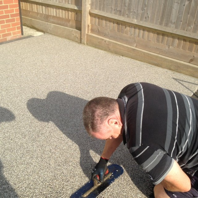 Applying the resin bound surface by hand